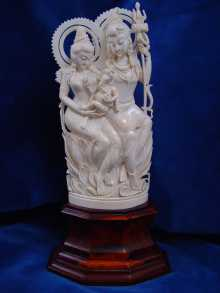 Ivory sculpture, Shiva and Parvati with Ganesha, dated about 1910, India.
